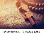 Rosary With Wooden Cross On...
