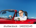 smiling man driving a red... | Shutterstock . vector #140232145