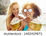 smiling young female friends... | Shutterstock . vector #1402429871