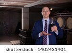 confident winemaker inviting to ... | Shutterstock . vector #1402431401