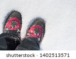 red hiking boots in a snowdrift.... | Shutterstock . vector #1402513571