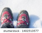 red hiking boots in a snowdrift.... | Shutterstock . vector #1402513577