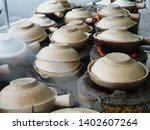 traditional stove and pot from... | Shutterstock . vector #1402607264