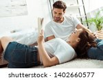 low angle view of handsome man... | Shutterstock . vector #1402660577