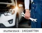 hand of car mechanicrench with... | Shutterstock . vector #1402687784