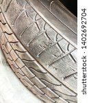 Small photo of Deteriorated and cracked wheel tire risked to the unbalanced and unsafe car