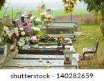 all saints day, cemetery, rainy day - stock photo