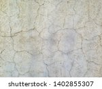 cream colored vintage concrete wall painted, big cracks, background stock texture