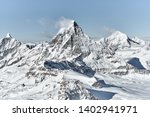 unusual view of Matterhorn from south  face in a bright winter day with a good weather with a little bit clouds near the summit
