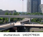 Small photo of McLean, Va./USA-5/19/19: A Silver Line train traverses an elevated stretch of track on the Washington, D.C. Metrorail system through Tysons Corner.