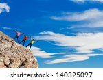 hikers at the top of a rock... | Shutterstock . vector #140325097