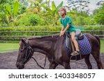 boy horseback riding ... | Shutterstock . vector #1403348057