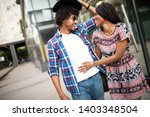 happy young black couple... | Shutterstock . vector #1403348504