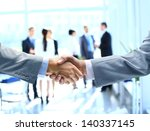 close up of businessmen shaking ... | Shutterstock . vector #140337145
