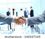 close up of businessmen shaking ... | Shutterstock . vector #140337145