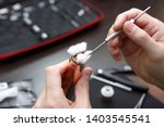 specialist replaces wick for... | Shutterstock . vector #1403545541