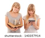 ebook vs book   girl holding a... | Shutterstock . vector #140357914