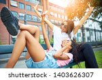 two carefree young girlfriends... | Shutterstock . vector #1403626307