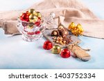 chocolate candy in shiny... | Shutterstock . vector #1403752334