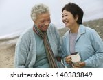 two cheerful middle aged female ... | Shutterstock . vector #140383849