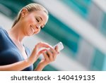 Business Woman Using App On A...