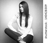 Photo of beautiful young woman in white jacket. Fashion photo - stock photo