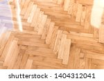 new wooden parquet floor.... | Shutterstock . vector #1404312041
