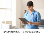 male medical assistant with... | Shutterstock . vector #1404313457