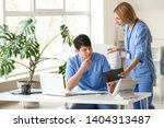 young medical assistants... | Shutterstock . vector #1404313487