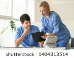 young medical assistants... | Shutterstock . vector #1404313514