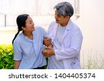 doctor supported the patient... | Shutterstock . vector #1404405374