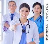 female doctor offering a... | Shutterstock . vector #1404431471