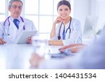 doctors consulting with each... | Shutterstock . vector #1404431534