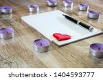 notepad with pen and red heart... | Shutterstock . vector #1404593777