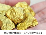gold nuggets natural on a white ... | Shutterstock . vector #1404594881