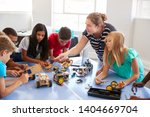 Stock photo students in after school computer coding class building and learning to program robot vehicle 1404669704