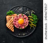 beef steak tartare with raw egg ...