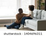 caring african american father... | Shutterstock . vector #1404696311