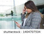 serious business woman thinking ... | Shutterstock . vector #1404707534