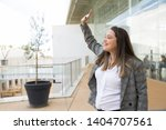 happy business woman greeting... | Shutterstock . vector #1404707561