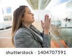business lady praying and... | Shutterstock . vector #1404707591