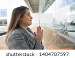 business woman praying and... | Shutterstock . vector #1404707597