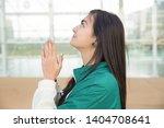 positive girl thanking god for... | Shutterstock . vector #1404708641
