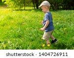 little boy side view. he is... | Shutterstock . vector #1404726911