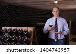 professional winemaker... | Shutterstock . vector #1404743957