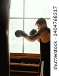 side view of sweaty young boxer ... | Shutterstock . vector #1404768317