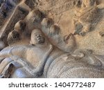 Historic Sculpture in South-India. Amazing Ancient stone carving of Indian Gods. ancient Hindu monolithic Indian rock-cut architecture. Mahabalipuram, Tamil Nadu. centuries old images in landscape.
