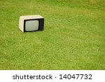 black and white tv on the grass.... | Shutterstock . vector #14047732