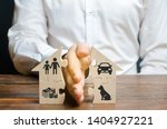 Stock photo a man shares a house with his palm with images of property children and pets divorce concept 1404927221