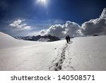 two hikers on snow plateau....